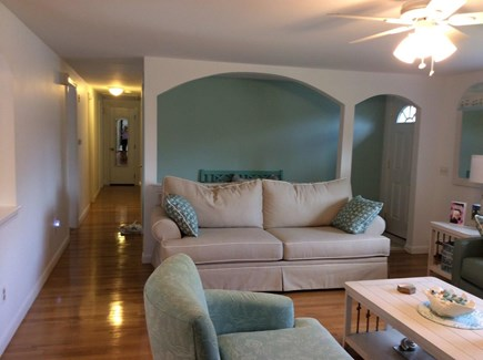 Dennis Cape Cod vacation rental - Living room with two couches, chair, bay window and tv.