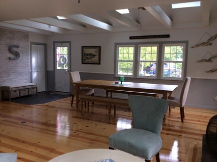 Dennis Cape Cod vacation rental - Cathedral ceiling family room with large table eat/play games