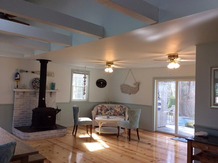Dennis Cape Cod vacation rental - Sitting area in family room with slider to one of two decks