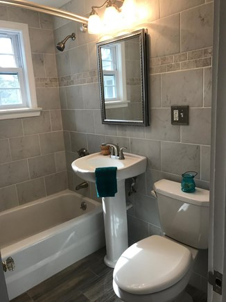 South Yarmouth Cape Cod vacation rental - Main bathroom -- bright;floor to ceiling tiles; full size bathtub