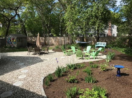 South Yarmouth Cape Cod vacation rental - Rear Yard showing Patio set, Firepit and Hammock