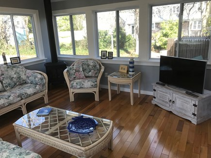 South Yarmouth Cape Cod vacation rental - Sunroom with large slide windows; vaulted ceiling; flatscreen TV