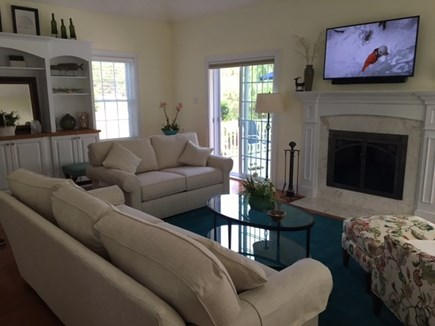 Brewster Cape Cod vacation rental - Living Room - Fireplace, Mounted Big Screen TV