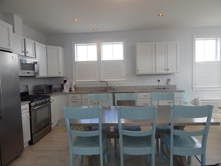 Dennis Port Cape Cod vacation rental - Kitchen and dining table - all new, stainless steel appliances,