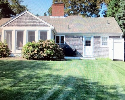 East Dennis Cape Cod vacation rental - Backyard looking toward house and private outdoor shower