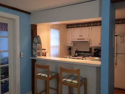 Mashpee, New Seabury, Maushop Village Cape Cod vacation rental - View of breakfast bar and kitchen from the living room.