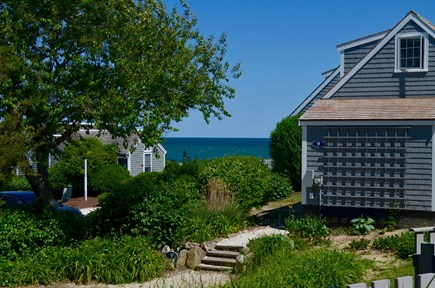 Mashpee, New Seabury, Maushop Village Cape Cod vacation rental - View from Patio.  Nantucket Sound in the distance.