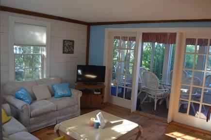 Mashpee, New Seabury, Maushop Village Cape Cod vacation rental - Living room looking towards the sunroom