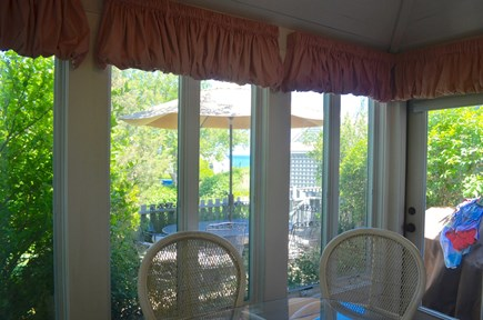 Mashpee, New Seabury, Maushop Village Cape Cod vacation rental - Sun room looking towards the patio and views of the ocean