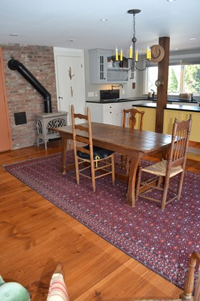 wellfleet Cape Cod vacation rental - Farm Table, Asian Rug from Turkey, Tree of Life Gas Fireplace