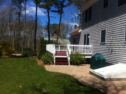 Brewster Cape Cod vacation rental - Large, flat backyard with deck, barbecue and outdoor shower