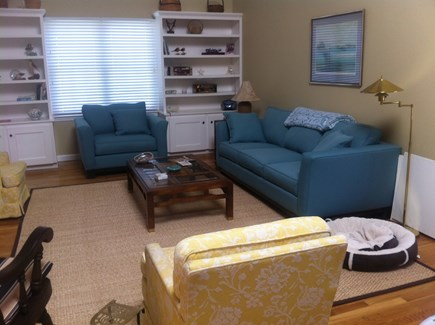 Brewster Cape Cod vacation rental - First floor family room with stereo, Smart TV, books, fireplace