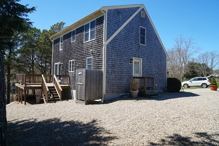 West Dennis Cape Cod vacation rental - Back view (deck furniture - table and chairs are coming)