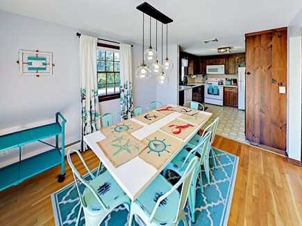 85 Cynthia Lane, Dennis Port Cape Cod vacation rental - Modern chandelier hangs above the dining table with seating for 8