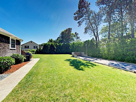 85 Cynthia Lane, Dennis Port Cape Cod vacation rental - Outdoor space has plenty of room for yard games & bocce court