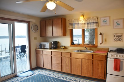 Mashpee Cape Cod vacation rental - Kitchen with access through sliders to the deck