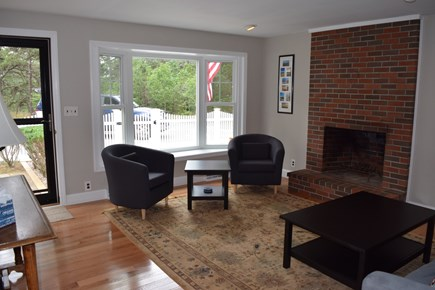 Wellfleet Cape Cod vacation rental - Living/sitting room leading from kitchen to fenced in patio