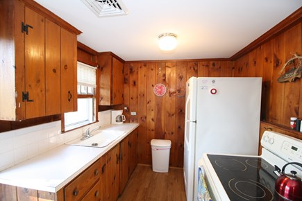 Dennis Port Cape Cod vacation rental - Galley Kitchen with view to sunrise on the deck