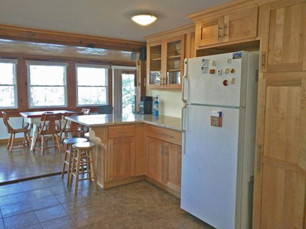 Harwich Cape Cod vacation rental - Kitchen with granite counters and eating island