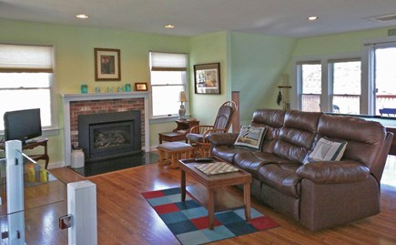 Harwich Cape Cod vacation rental - Relaxing living room and deck with beautiful views of the pond