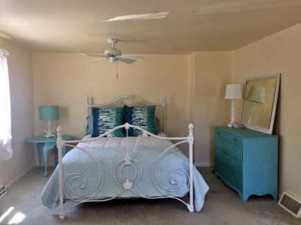 West Yarmouth Cape Cod vacation rental - Captains room queen bed, ceiling fan, slider door to deck
