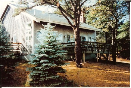 Eastham Cape Cod vacation rental - Back of house w/back deck to the right, front deck to the left