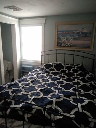 Dennisport Cape Cod vacation rental - Master bedroom with half bath.