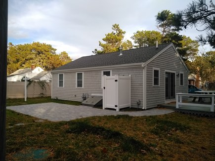Dennisport Cape Cod vacation rental - Backyard with patio and attached deck.