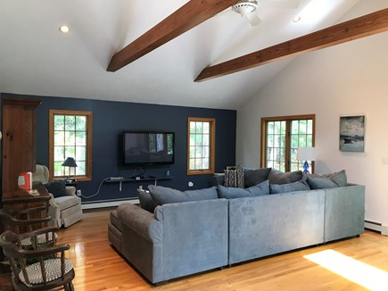North Eastham, bayside Cape Cod vacation rental - TV room with sectional, flat screen (Roku, DVD, Super Nintendo)
