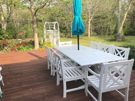 North Eastham, bayside Cape Cod vacation rental - Large dining table faces a beautiful garden and yard