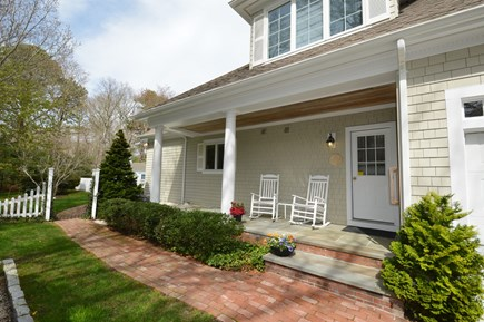 Osterville Osterville vacation rental - Wonderful seating area on porch with walkway to back yard