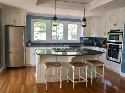 Eastham Cape Cod vacation rental - Open Floor plan with a great kitchen! Center island gas stove.