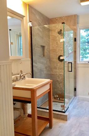 Eastham Cape Cod vacation rental - Remodel front bathroom with beach pebble glass enclosed shower.