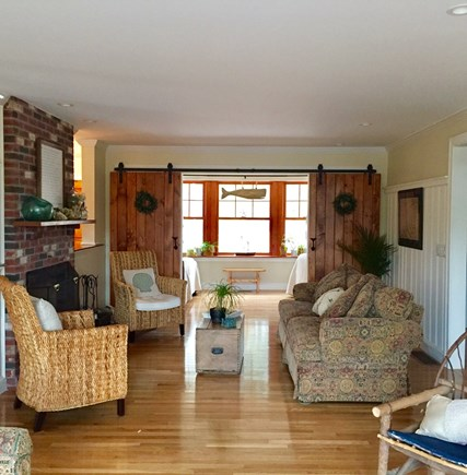 Eastham Cape Cod vacation rental - Open living room with barn doors leading into 3rd sleeping area.