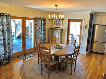 Eastham Cape Cod vacation rental - View of the dining area with large slider to expansive deck.