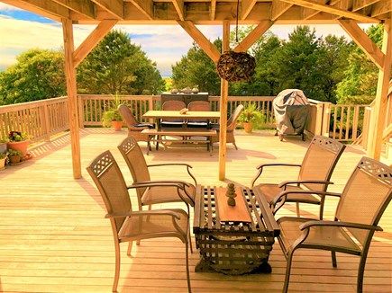Eastham Cape Cod vacation rental - Beautiful expansive lower deck with dining set and extra seating.