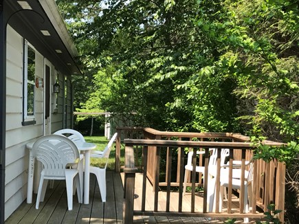 South Yarmouth Cape Cod vacation rental - Deck off Kitchen to relax + umbrella