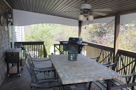 Eastham Cape Cod vacation rental - Covered deck with grill and table