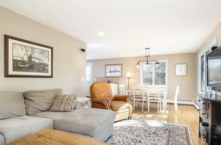 Chatham Cape Cod vacation rental - Eating area and family room (media center) overlooking backyard