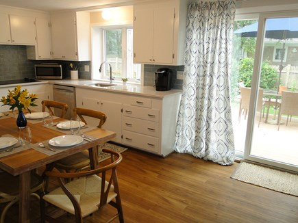 Falmouth Cape Cod vacation rental - Open kitchen with slider to deck, patio and private yard