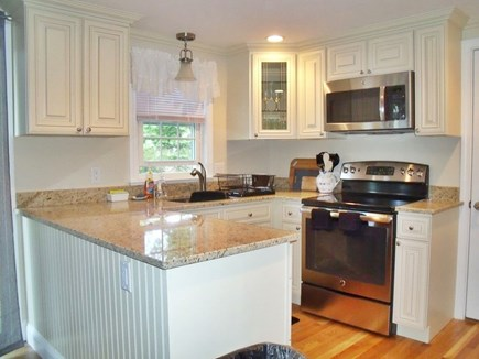 Brewster Cape Cod vacation rental - Kitchen has new stainless steel appliances, granite counter tops