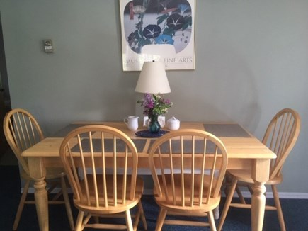 Eastham Cape Cod vacation rental - Dining table seats up to six with bench under table.