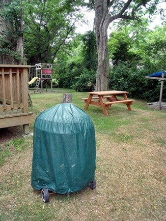 Eastham Cape Cod vacation rental - Off the deck picnic table & charcoal grill, swing set & sandbox