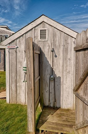 Centerville Centerville vacation rental - Outdoor Shower and garden shed with beach chairs, yard games etc.