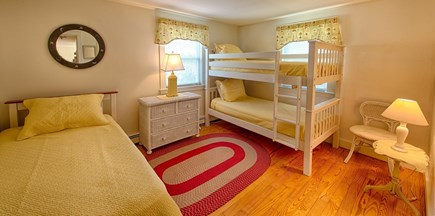 Centerville Centerville vacation rental - The sunshine bedroom with 3 twin beds and window a/c unit