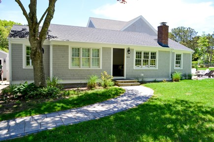 Mashpee, Popponesset Cape Cod vacation rental - Exterior of house. Large driveway with ample parking to the left.
