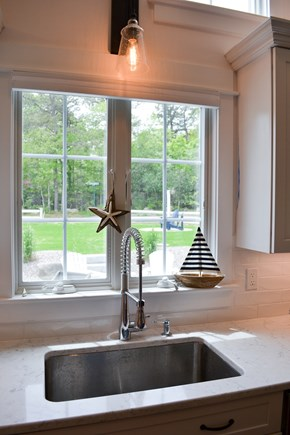 Mashpee, Popponesset Cape Cod vacation rental - Kitchen sink overlooking the patio and yard.