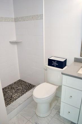 Mashpee, Popponesset Cape Cod vacation rental - Master bathroom with standing shower.