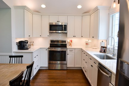 Mashpee, Popponesset Cape Cod vacation rental - Open kitchen with new appliances and pantry.