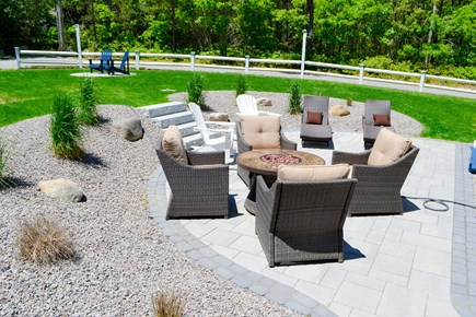 Mashpee, Popponesset Cape Cod vacation rental - Patio with fire pit and chaise lounges.